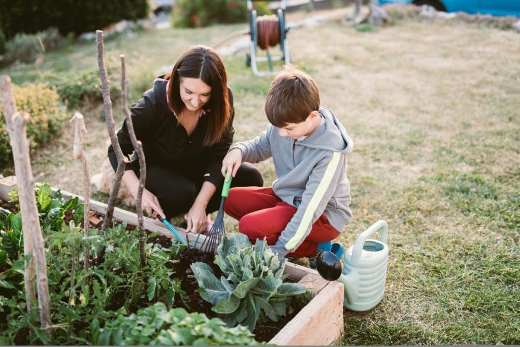 mother and son planting garden